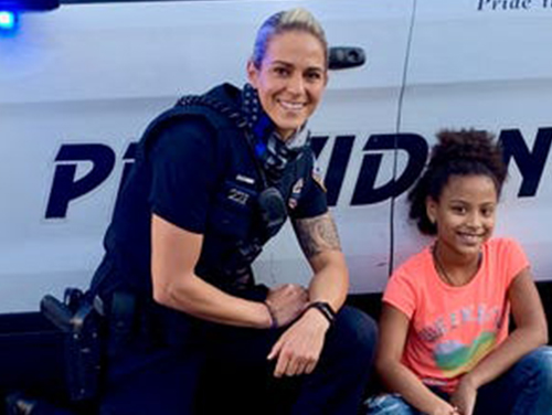 Former Franklin Pierce University basketball star Kirsten Doldoorian is now a team player as one of Providence's finest.