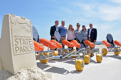 Adrienne Olney—on behalf of her class and Franklin Pierce—and non-profit partner SMILE Mass donated five beach wheelchair chairs to Governor Chris Sununu and the New Hampshire State Parks.